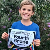 student with first day sign