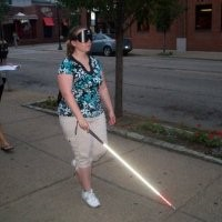 This is a picture of me walking down a city street with a cane under blindfold during my final exam in Pittsburgh PA.