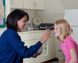 school nurse taking temperature